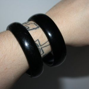 Two black chunky bangle bracelets